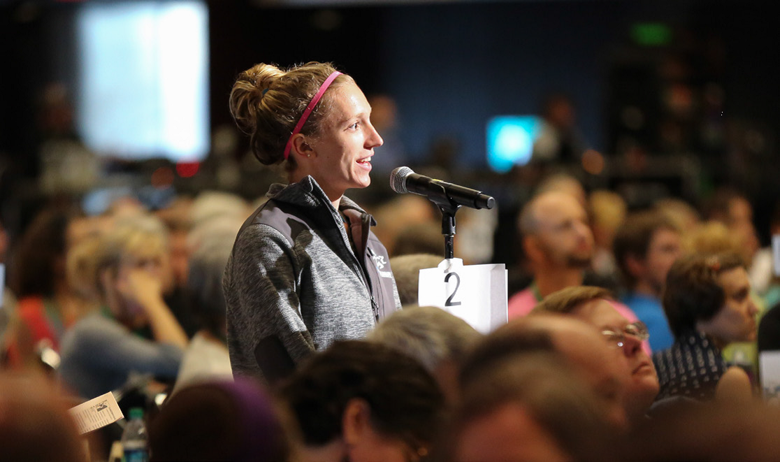 Hannah Chappell-Dick, delegate for First Mennonite of Bluffton, speaks during open mic time, Friday, July 3, 2015, Kansas City, Missouri. Photo by Abby Graber