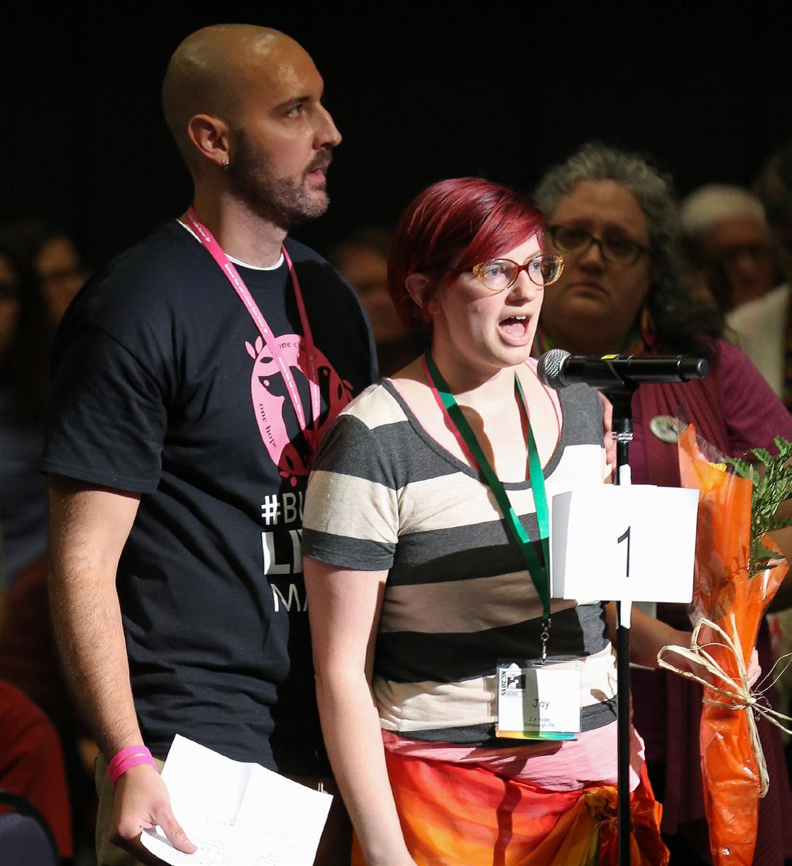 Jennifer Yoder of Pink Menno addresses the delegates, Saturday, July 4, 2015, Kansas City, Missouri.