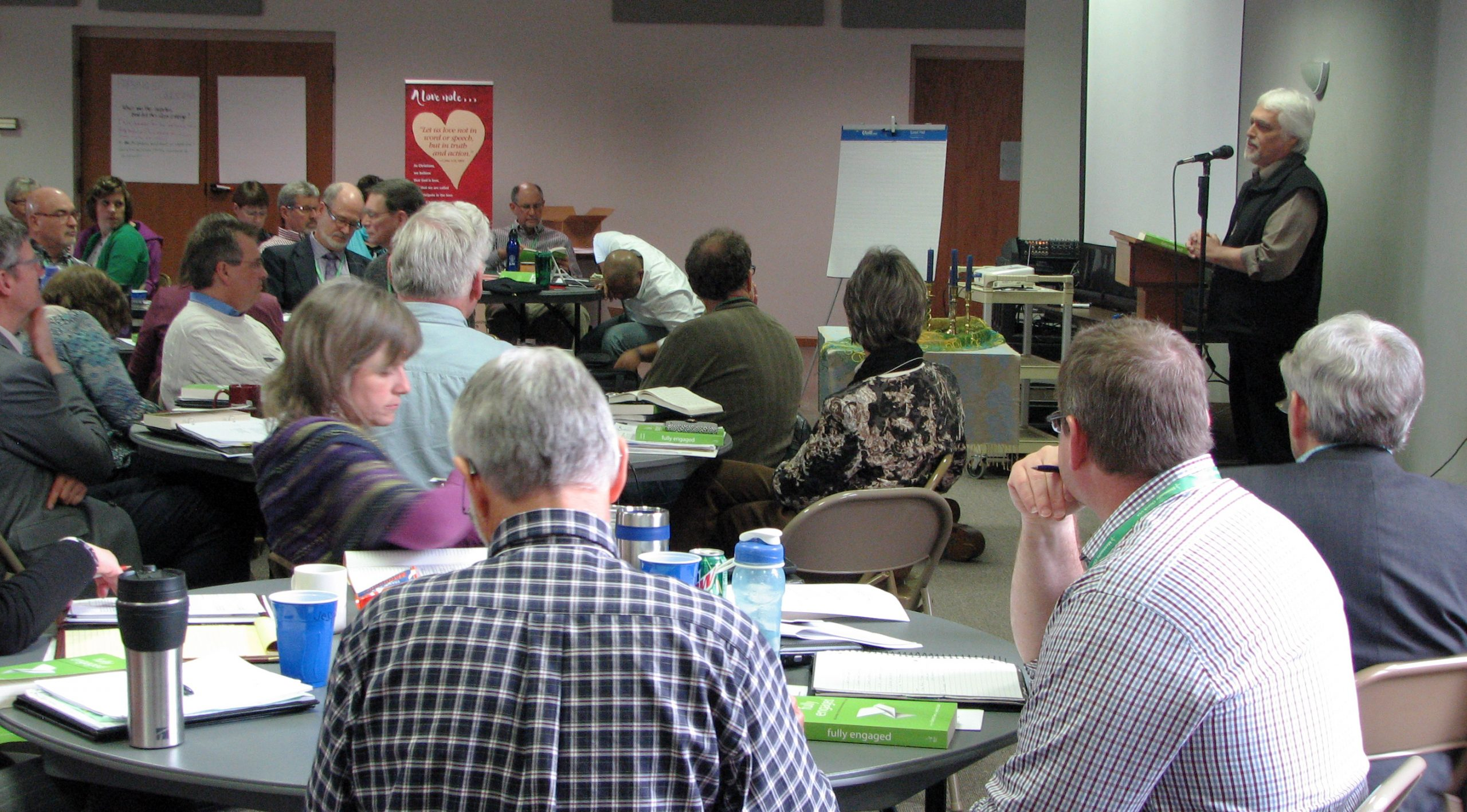 James Krabill, senior executive for Global Ministries for Mennonite Mission Network, presents an overview of Fully Engaged: Missional Church in an Anabaptist Voice, a new book he has co-edited with Stanley Green, executive director for Mission Network, at the March Constituency Leaders Council meeting at Silverwood Mennonite Church in Goshen, Indiana. (Photo by Annette Brill Bergstresser)