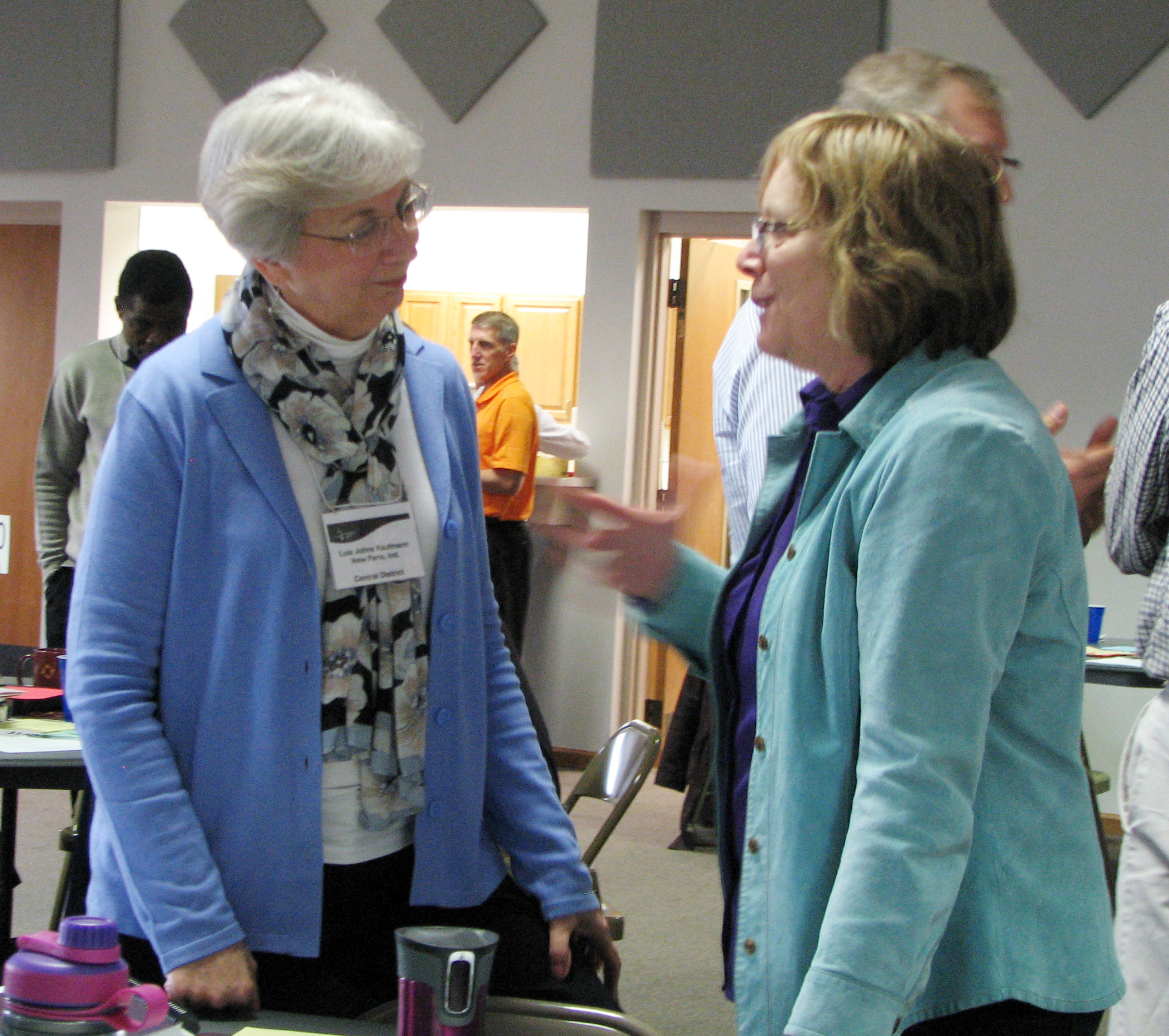 Lois Johns Kaufmann, conference minister for Central District Conference, talks with Nancy Kauffmann, denominational minister for Mennonite Church USA, at the March Constituency Leaders Council meeting at Silverwood Mennonite Church in Goshen, Indiana. At the meeting, Johns Kaufmann was honored for her years of ministry. She plans to retire this summer. (Photo by Annette Brill Bergstresser)