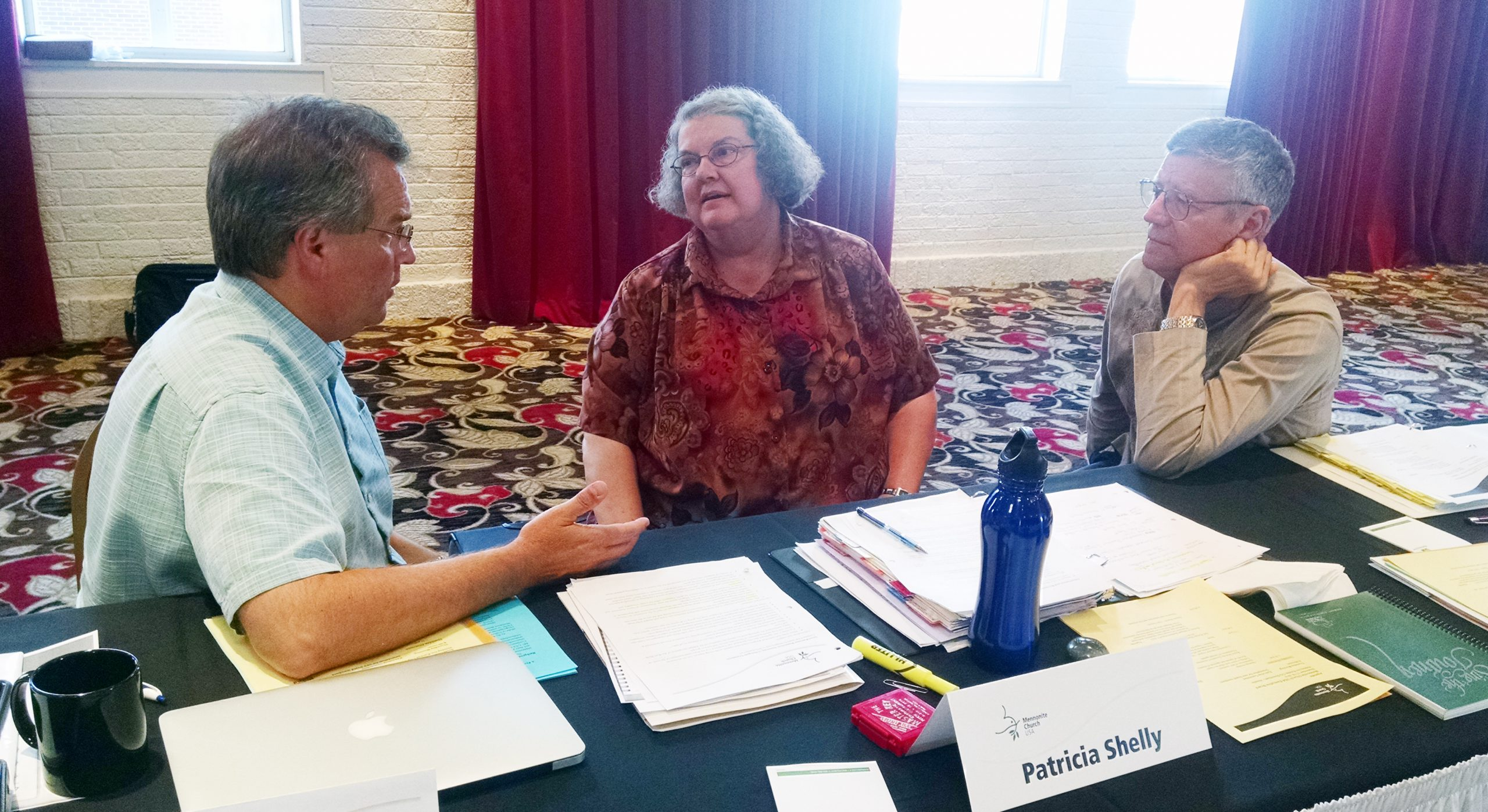David Boshart, Wellman, Iowa, moderator-elect; Patricia Shelly, Newton, Kansas, moderator; and Ervin Stutzman, Harrisonburg, Virginia, executive director, during the Mennonite Church USA Executive Board's Sept. 17–19 meeting in Kansas City, Missouri.