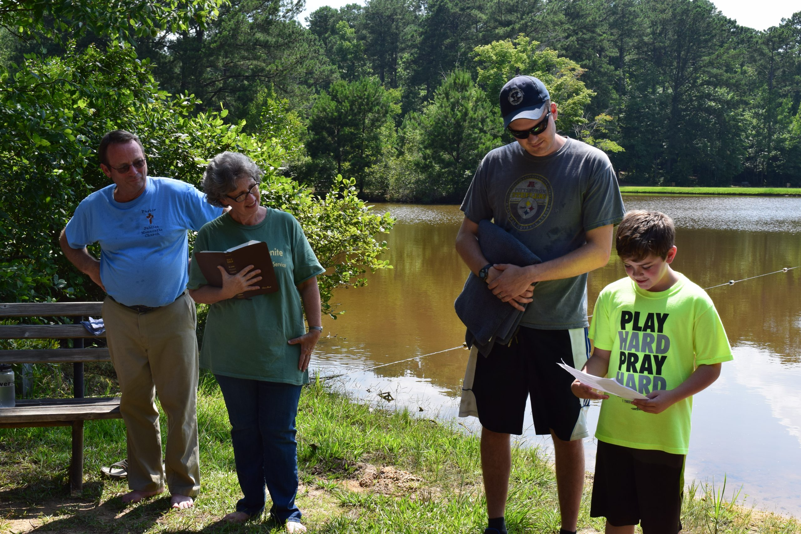 Jubilee Mennonite Church provides leadership at Pine Lake Fellowship Camp in Meridian, Mississippi. Pastors Duane and Elaine Maust look on as Noah Chisolm prepares for baptism with his mentor, Matt Graybill. (Photo provided by Laurie Oswald Robinson)