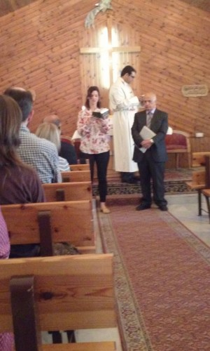 Rachel Ringerberg Miller reading scripture in a church at Beit Sahour